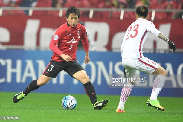 Tomoya Ugajin of Urawa Red Diamonds in action during the AFC Champions League Group F match between Urawa Red Diamonds and Shanghai SIPG FC at...