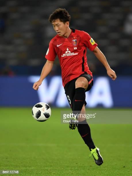Tomoya Ugajin of Urawa Red Diamonds in action during the FIFA Club World Cup match between Al Jazira and Urawa Red Diamonds at Zayed Sports City...