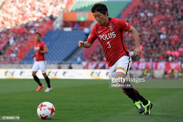 Tomoya Ugajin of Urawa Red Diamonds in action during the JLeague J1 match between Urawa Red Diamonds and Kashima Antlers at Saitama Stadium on May 4...