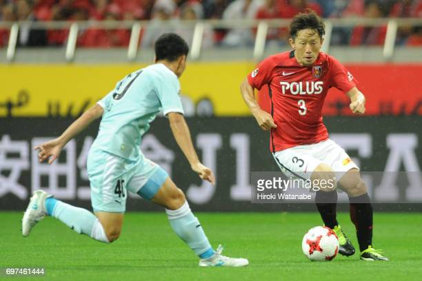 Tomoya Ugajin of Urawa Red Diamonds in action during the JLeague J1 match between Urawa Red Diamonds and Jubilo Iwata at Saitama Stadium on June 18...