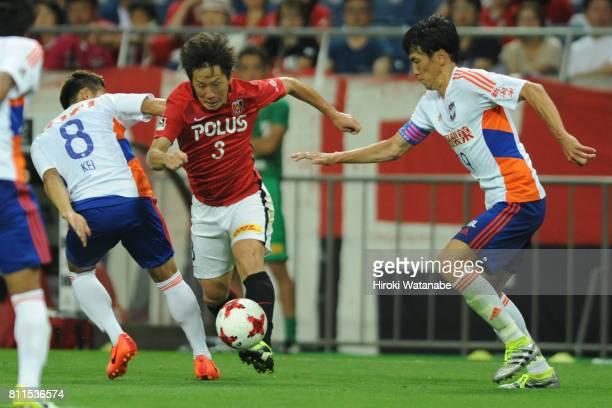 Tomoya Ugajin of Urawa Red Diamonds in action during the JLeague J1 match between Urawa Red Diamonds and Albirex Niigata at Saitama Stadium on July 9...