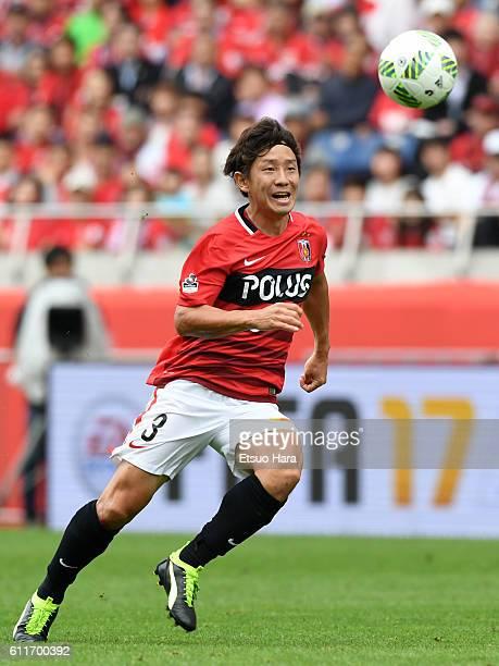 Tomoya Ugajin of Urawa Red Diamonds in action during the JLeague match between Urawa Red Diamonds and Gamba Osaka at Saitama Stadium on October 1...