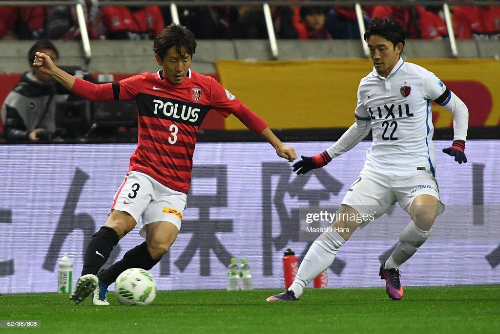 Tomoya Ugajin of Urawa Red Diamonds in action during the J.League Championship Final second leg match between Urawa Red Diamonds and Kashima Antlers at Saitama Stadium on December 3, 2016 in Saitama, Japan.