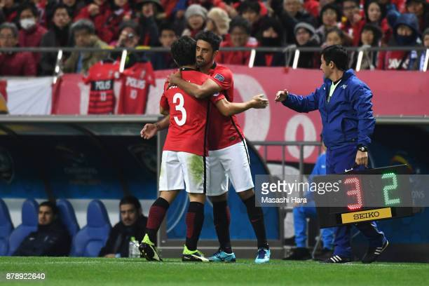 Tomoya Ugajin of Urawa Red Diamonds is replaced by Mauricio during the AFC Champions League Final second leg match between Urawa Red Diamonds and...