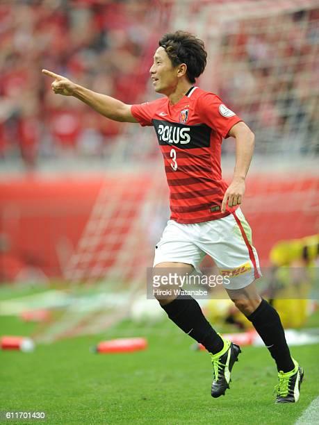 Tomoya Ugajin of Urawa Reds celebrates the third goal during the JLeague match between Urawa Red Diamonds and Gamba Osaka at Saitama Stadium on...