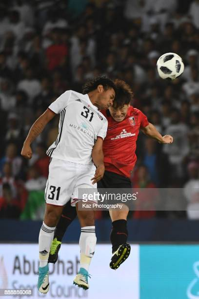 Tomoya Ugajin of Urawa reds compete for the header with Romarinho of Al Jazira> on December 9 2017 in Abu Dhabi United Arab Emirates