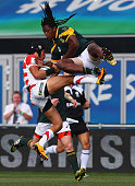 Tomoya Yamamura of Japan and S'Busiso Nkosi of South Africa challenge for the ball during the World Rugby U20 Championship match between South Africa...