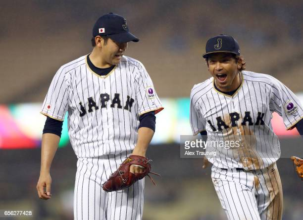Tomoyuki Sugano and Nobuhiro Matsuda of Team Japan react in the top of the third inning of Game 2 of the Championship Round of the 2017 World...