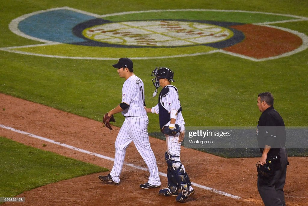 Tomoyuki Sugano #11(L) and Seiji Kobayashi #22(R) of Japan reacts during the Game 2 of the Championship Round of the 2017 World Baseball Classic between United States and Japan at Dodger Stadium on March 21, 2017 in Los Angeles, California.