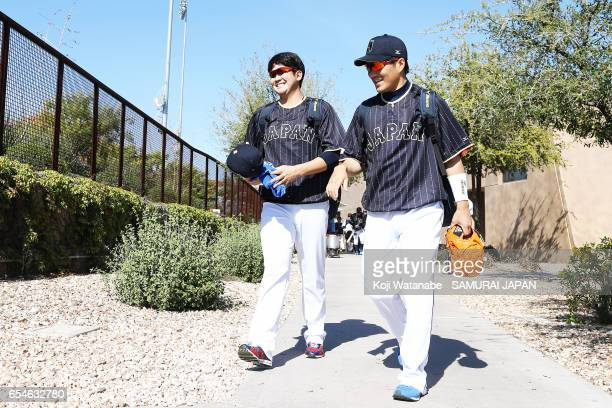 Tomoyuki Sugano and Takahiro Norimoto of Japan in action during a workout ahead of the World Baseball Classic Championship Round at Camelback Ranch...