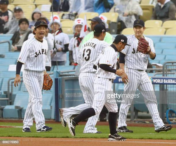 Tomoyuki Sugano Japan starter in a World Baseball Classic semifinal game against the United States in Los Angeles on March 21 heads to the bench...