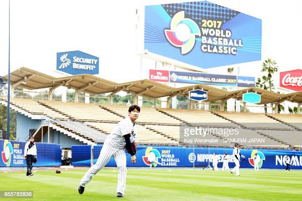 Tomoyuki Sugano of Japan in action during a training session ahead of the World Baseball Classic Championship Round at Dodger Stadium on March 20...
