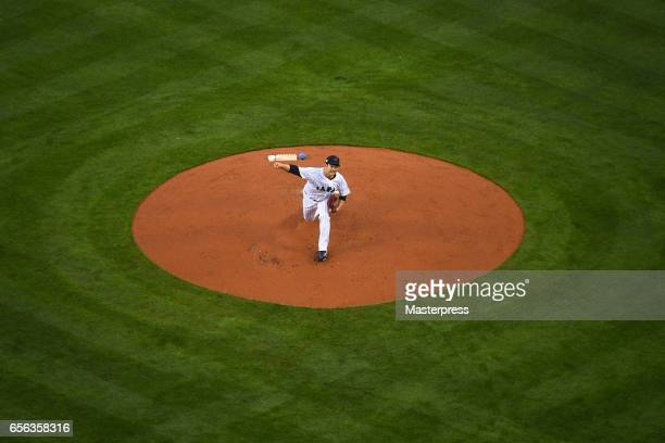 Tomoyuki Sugano of Japan pitches during the Game 2 of the Championship Round of the 2017 World Baseball Classic between United States and Japan at...