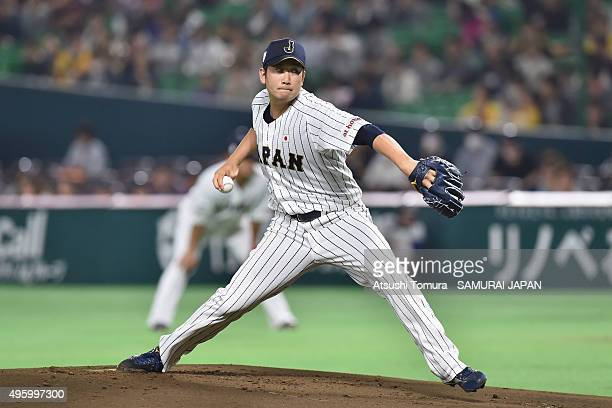 Tomoyuki Sugano of Japan pitches in the bottom half of the first inning during the sendoff friendly match for WBSC Premier 12 between Japan and...