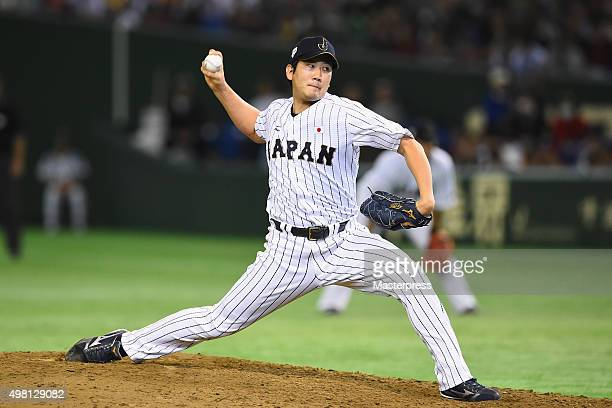 Tomoyuki Sugano of Japan pitches in the top half of fourth inning during the WBSC Premier 12 third place play off match between Japan and Mexico at...