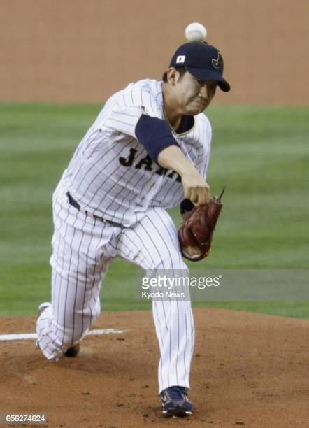 Tomoyuki Sugano of Japan starts in a World Baseball Classic semifinal game against the United States at Dodger Stadium in Los Angeles on March 21...