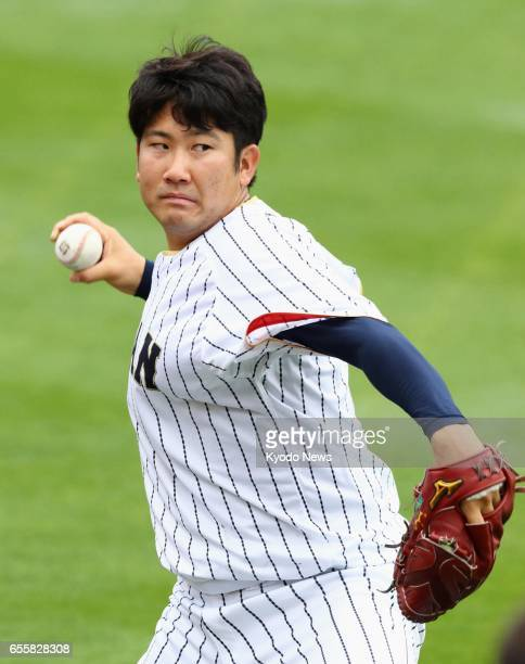 Tomoyuki Sugano of Japan's World Baseball Classic team plays catch in Los Angeles on March 20 2017 Sugano is scheduled to start in a WBC semifinal...