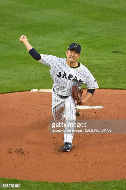 Tomoyuki Sugano of team Japan pitches against team United States in the first inning during Game 2 of the Championship Round of the 2017 World...