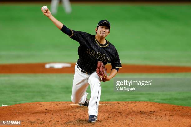 Tomoyuki Sugano of Team Japan pitches in the second inning during Game 3 of Pool B against Team Australia at the Tokyo Dome on Wednesday March 8 2017...