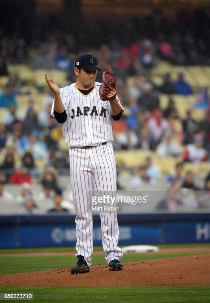 Tomoyuki Sugano of Team Japan reacts on the mound during Game 2 of the Championship Round of the 2017 World Baseball Classic against Team USA on...
