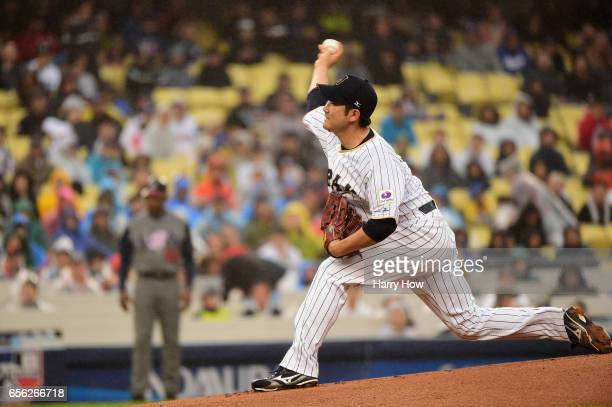 Tomoyuki Sugano of the Japan pitches in the first inning against team United States during Game 2 of the Championship Round of the 2017 World...