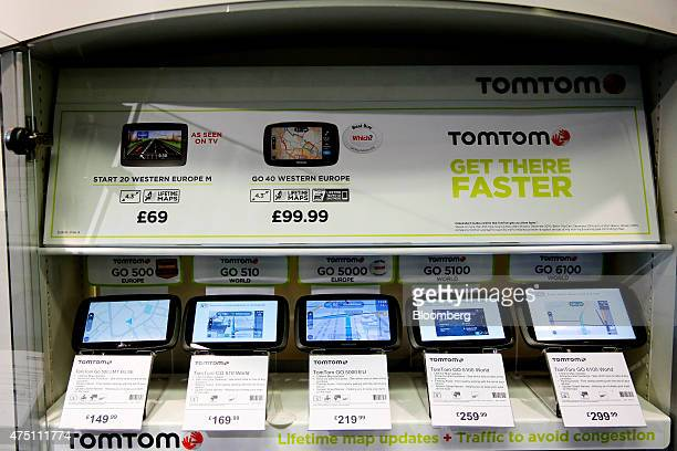 TomTom Go satellite navigation systems manufactured by TomTom NV sit on display in a Halfords Group Plc store in Manchester UK on Friday May 29 2015...