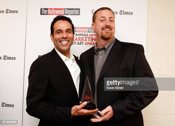 Tomy Drissi and John Duncan accept the Best Theatrical Standee Award for 'The Simpsons Movie' backstage during The Hollywood Reporter's 37th Annual...