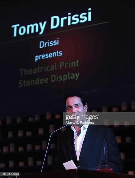 Tomy Drissi presents the Hollywood Reporter award for best Theatrical Print Standee Display at the 39th Annual Key Art Awards held at Vibiana on June...