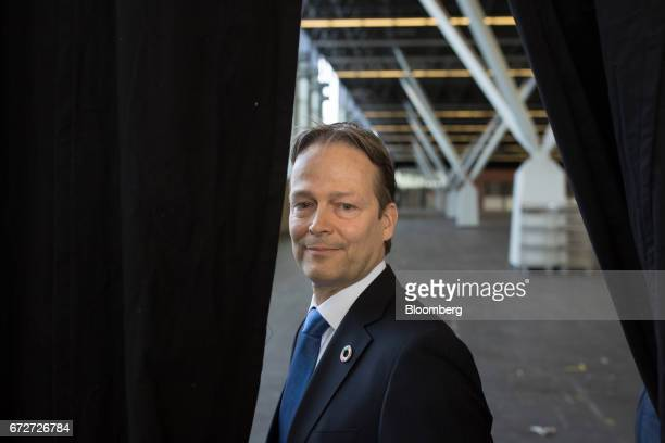 Ton Buechner chief executive officer of Akzo Nobel NV departs after speaking to employees ahead of a shareholders' meeting in Amsterdam Netherlands...