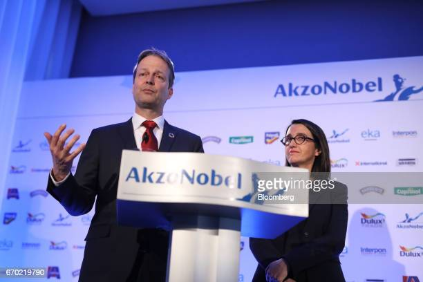 Ton Buechner chief executive officer of Akzo Nobel NV left gestures as Maelys Castella chief financial officer of Akzo Nobel NV looks on during a...