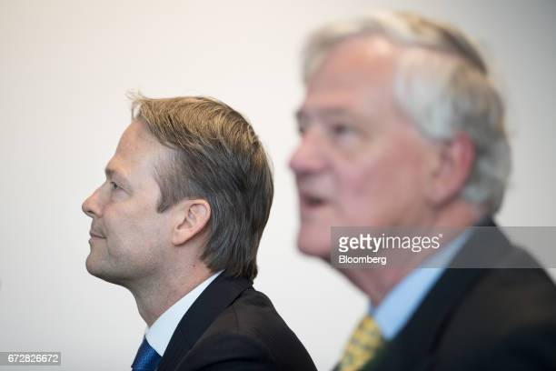 Ton Buechner chief executive officer of Akzo Nobel NV left looks on as Antony Burgmans chairman of Akzo Nobel NV speaks during a news conference in...