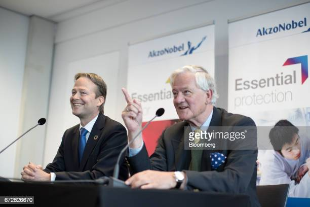Ton Buechner chief executive officer of Akzo Nobel NV left reacts as Antony Burgmans chairman of Akzo Nobel NV gestures during a news conference in...