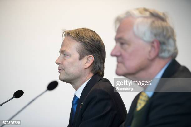 Ton Buechner chief executive officer of Akzo Nobel NV left speaks as he sits beside Antony Burgmans chairman of Akzo Nobel NV during a news...