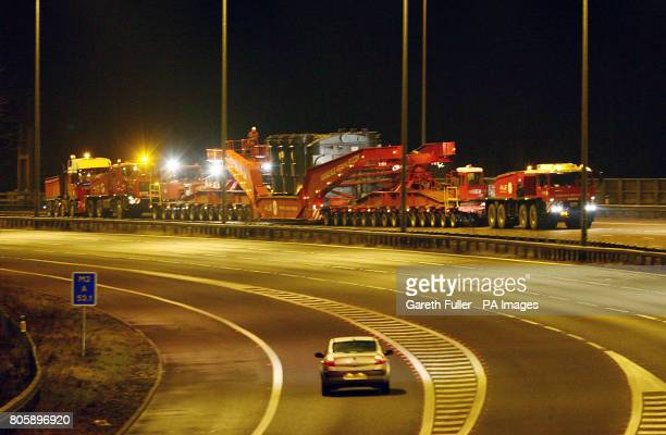A 428 ton generator is carried on a lorry measuring 10424 metres in length along the M2 near Chatham in Kent during its journey from Chatham Docks to...