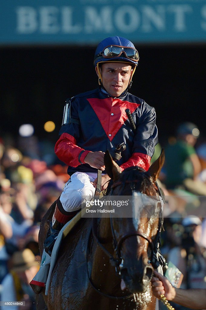 Tonalist #11, ridden by <a gi-track='captionPersonalityLinkClicked' href=/galleries/search?phrase=Joel+Rosario&family=editorial&specificpeople=6495860 ng-click='$event.stopPropagation()'>Joel Rosario</a>, celebrates after winning the 146th running of the Belmont Stakes at Belmont Park on June 7, 2014 in Elmont, New York.