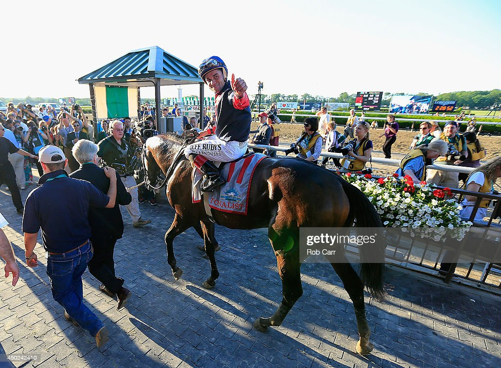 Tonalist #11, ridden by <a gi-track='captionPersonalityLinkClicked' href=/galleries/search?phrase=Joel+Rosario&family=editorial&specificpeople=6495860 ng-click='$event.stopPropagation()'>Joel Rosario</a>, celebrates in the winner's circle after winning the 146th running of the Belmont Stakes at Belmont Park on June 7, 2014 in Elmont, New York.