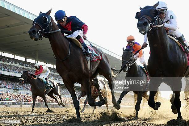 Tonalist ridden by Joel Rosario crosses the finish line to win the 146th running of the Belmont Stakes at Belmont Park on June 7 2014 in Elmont New...