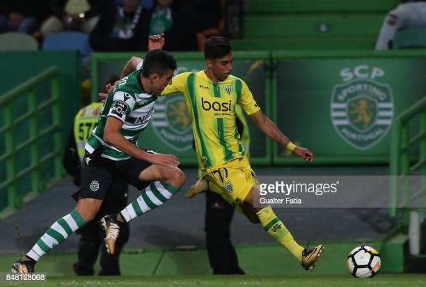 Tondela forward Murilo from Brazil with Sporting CP midfielder Rodrigo Battaglia from Argentina in action during the Primeira Liga match between...