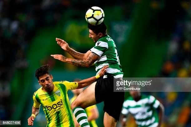 Tondela's Brazilian forward Murilo Freitas vies with Sporting's Argentine midfielder Alan Ruiz during the Portuguese league football match Sporting...