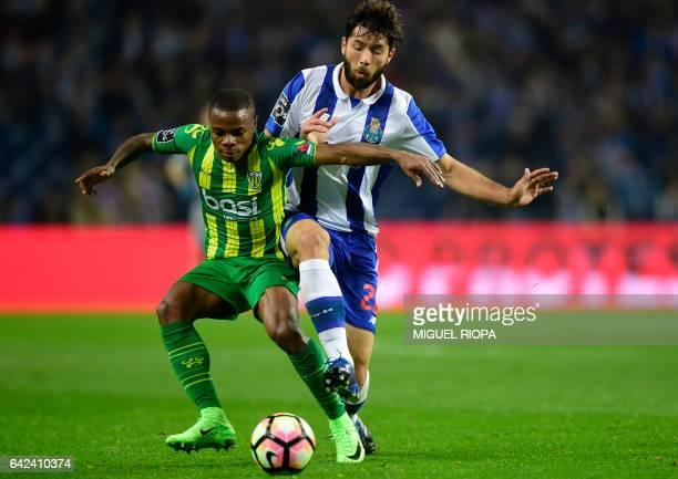 Tondela's Venezuelan forward Jhon Murillo vies with Porto's Brazilian defender Felipe during the Portuguese league football match FC Porto vs CD...