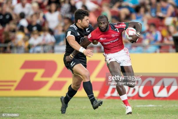 Tone Ng Shiu of New Zealand tries to stop Dennis Onkeo Ombachi of Kenya who runs with the ball during the match New Zealand vs Kenya Day 2 of the...