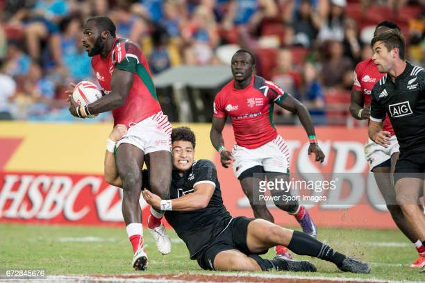 Tone Ng Shiu of New Zealand tries to tackle Dennis Onkeo Ombachi of Kenya who runs with the ball during the match New Zealand vs Kenya Day 2 of the...