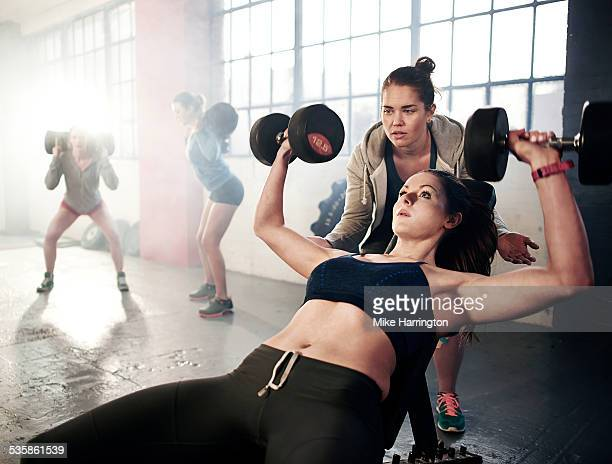 Toned female working out in industrial gym.