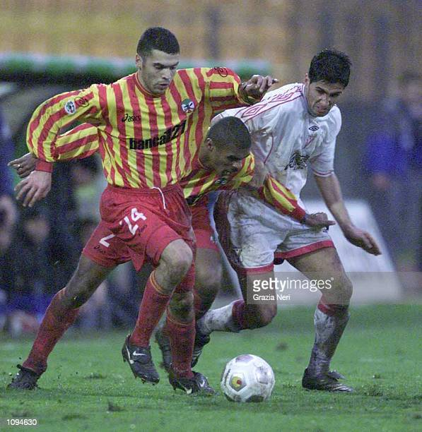 Tonetto of Lecce and Juarez of Atalanta in action during the SERIE A 14th Round League match between Lecce and Vicenza played at the Via Del Mare...