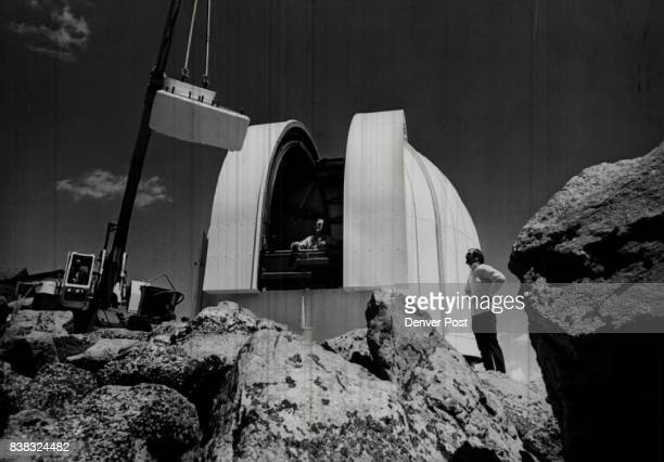 Toney Carruthers right chief production engineer for EalingBeck Watford England supervises the installation of the observatory telescope Credit...