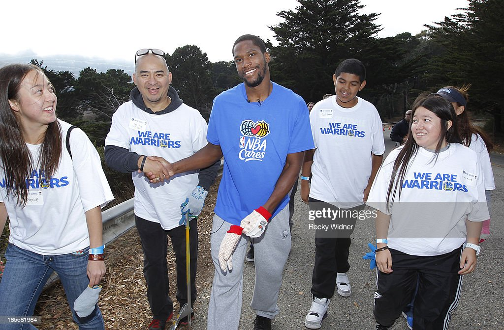Toney Douglas chats with some volunteers on their way to clean up McLaren park during Warriors Day Of Service as part of NBA Cares Week Of Service on October 21, 2013 in San Francisco, California.