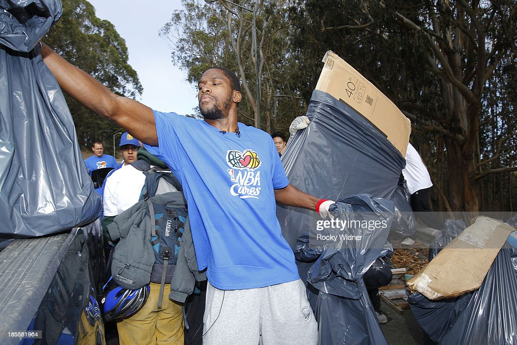 Toney Douglas does his part to clean up McLaren park during Warriors Day Of Service as part of NBA Cares Week Of Service on October 21, 2013 in San Francisco, California.