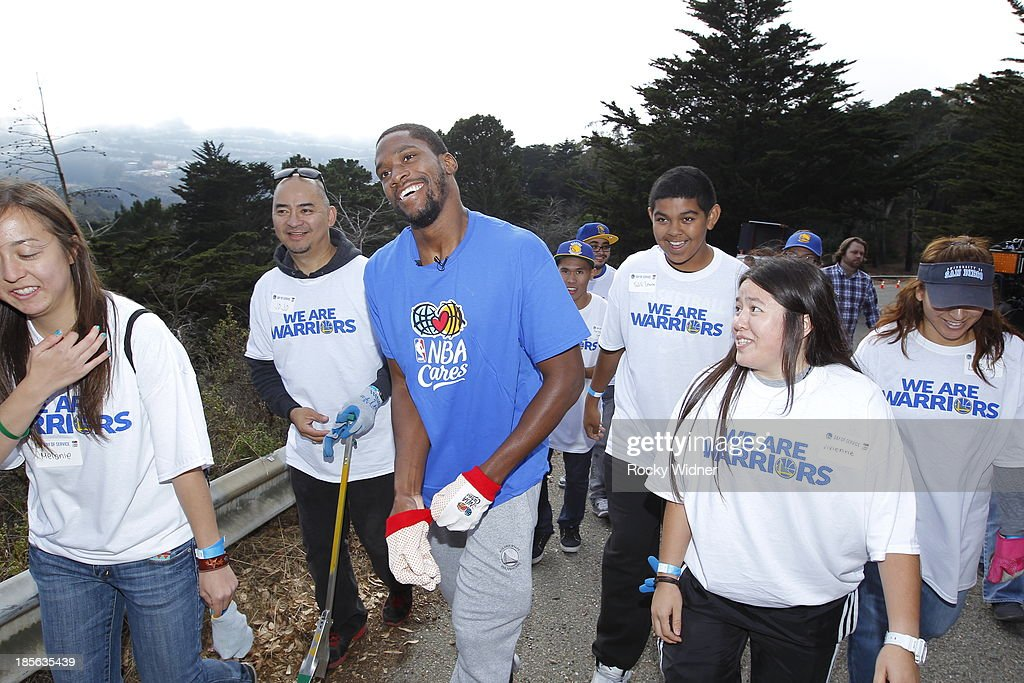 Toney Douglas helps clean up McLaren park during Warriors Day Of Service as part of NBA Cares Week Of Service on October 21, 2013 in San Francisco, California.