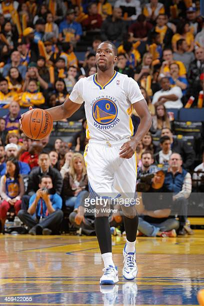 Toney Douglas of the Golden State Warriors dribbles against the Los Angeles Lakers on December 21 2013 at Oracle Arena in Oakland California NOTE TO...
