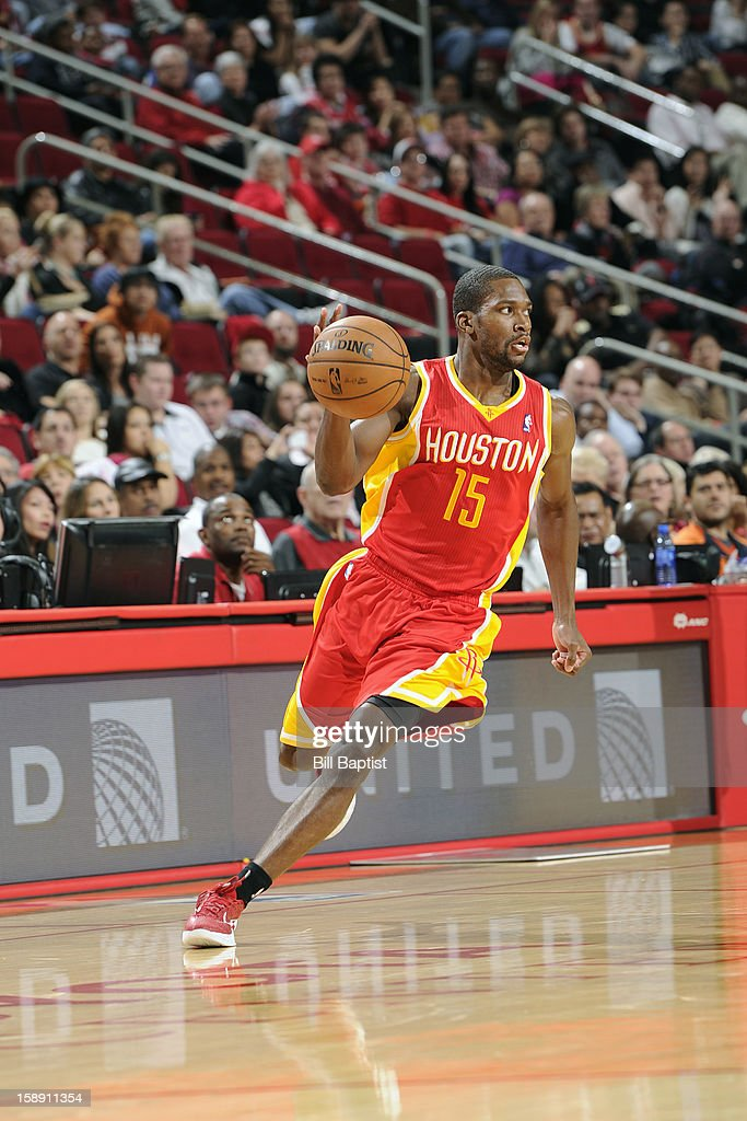 <a gi-track='captionPersonalityLinkClicked' href=/galleries/search?phrase=Toney+Douglas&family=editorial&specificpeople=2536966 ng-click='$event.stopPropagation()'>Toney Douglas</a> #15 of the Houston Rockets brings the ball up court against the Atlanta Hawks on December 31, 2012 at the Toyota Center in Houston, Texas.